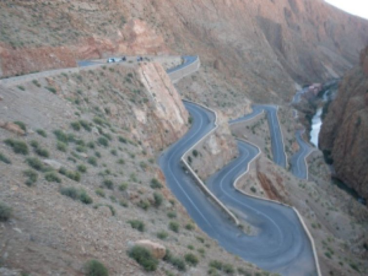 Editor of Leipzig Glocal travels across Atlas Mountains, on winding roads, to Sahara Desert, Morocco, 2010.