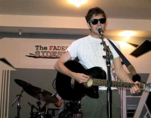 """Ezra Furman (2007)"" by Stab At Sleep from Florida, United States - EZRA FURMAN AND THE HARPOONS. Licensed under CC BY-SA 2.0 via Wikimedia Commons."
