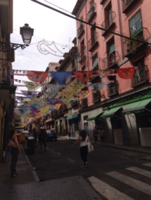Street in La Latina decked out during the day for Fiestas de la Paloma in Madrid. Photo by A. Ribeiro.