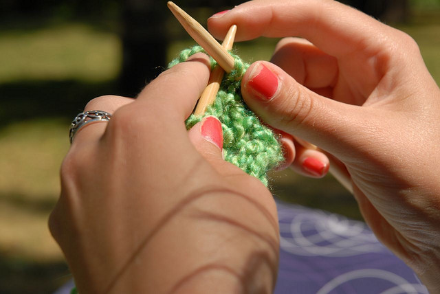 Hands knitting green